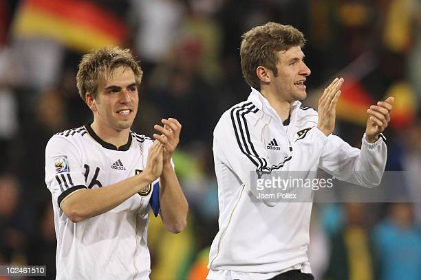 Philipp Lahm and Thomas Mueller of Germany celebrate victory after the 2010 FIFA World Cup South Africa Round of Sixteen match between Germany and...