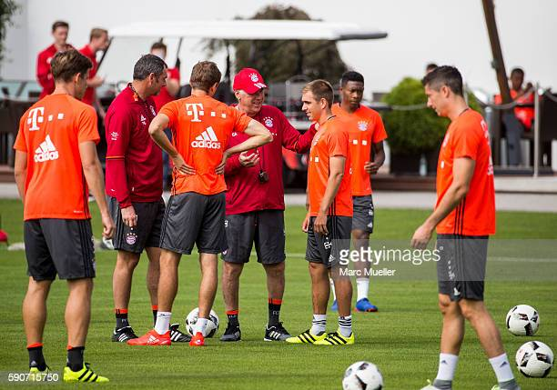 Philipp Lahm and trainer Carlo Ancelotti of FC Bayern Munich are seen during an training session on August 17 2016 in Munich Germany