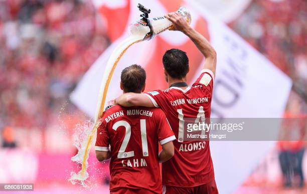 Philipp Lahm and Xabi Alonso of Bayern Muenchen celebrate following the Bundesliga match between Bayern Muenchen and SC Freiburg at Allianz Arena on...