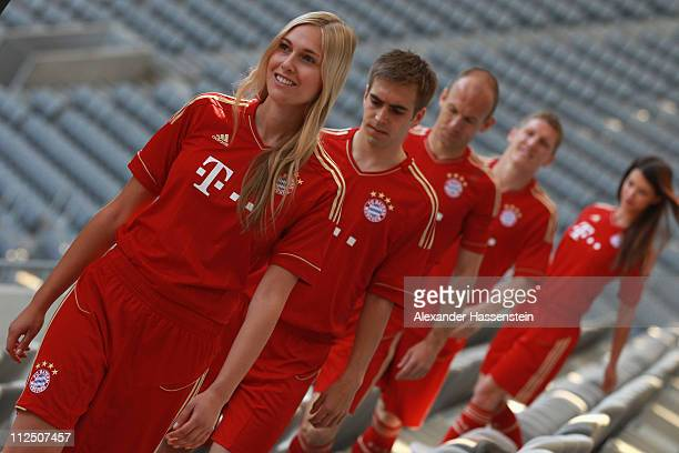 Philipp Lahm arrives with his team mates Arjen Robben Bastian Schweinsteiger and models for the presentation of the new FC Bayern Muenchen home...