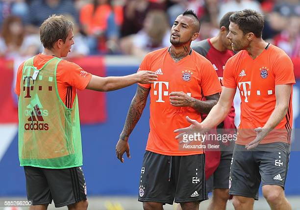 Philipp Lahm Arturo Vidal and Xabi Alonso of FC Bayern Muenchen discuss during a training session at the AUDI Summer Tour USA 2016 ahead of the...