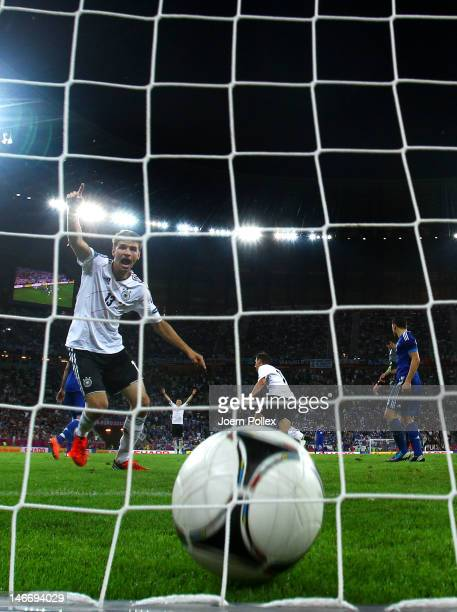 Philipp Lahm celebrates as Miroslav Klose of Germany scores their third goal during the UEFA EURO 2012 quarter final match between Germany and Greece...