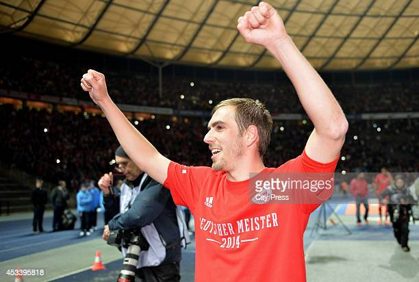 Philipp Lahm celebrates the win during the Bundesliga game between Hertha BSC and Borussia Dortmund on march 25 2014 in Berlin Germany