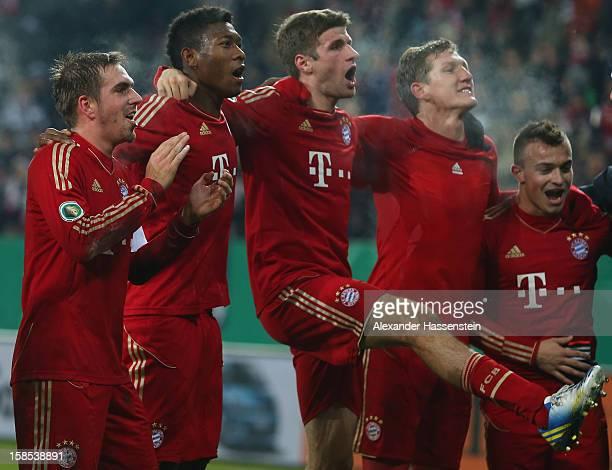 Philipp Lahm, David Alaba, Thomas Mueller, Bastian Schweinsteiger and Xherdan Shaqiri all of Muenchen celebrate victory after winning the DFB cup...