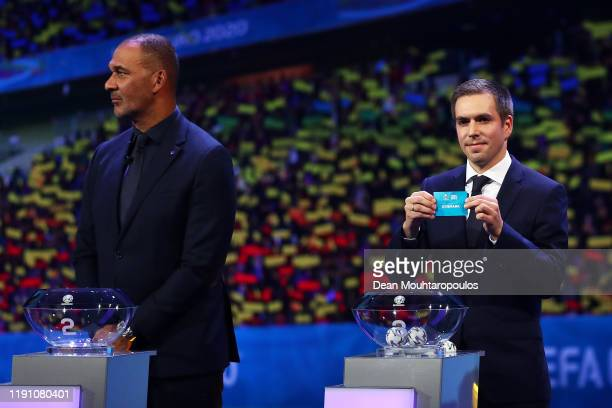Philipp Lahm Former Germany player draws Denmark from the pot during the UEFA Euro 2020 Final Draw Ceremony at the Romexpo on November 30 2019 in...