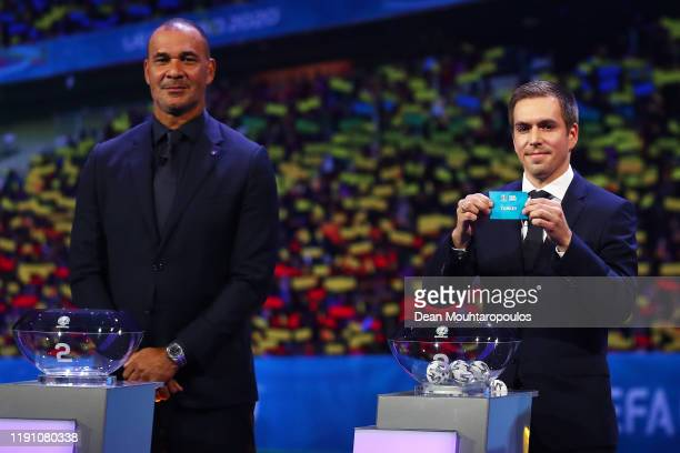 Philipp Lahm Former Germany player draws Turkey from the pot during the UEFA Euro 2020 Final Draw Ceremony at the Romexpo on November 30 2019 in...