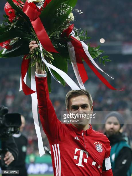 Philipp Lahm is honoured for 500 Bundesliga appearances prior to the DFB Cup Round Of 16 match between Bayern Muenchen and VfL Wolfsburg at Allianz...