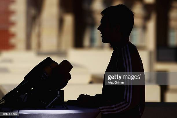 Philipp Lahm is silhouetted during a press conference of Bayern Muenchen at the Grand Heritage Hotel on January 4 2012 in Doha Qatar