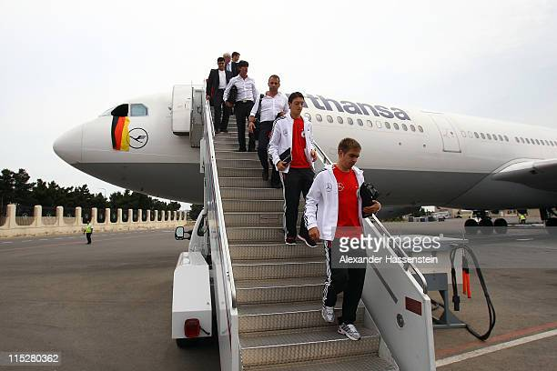 Philipp Lahm Mesut Oezil assistent coach Hansi Flick and head coach Joachim Loew of Germany arrive with the team at Heydar Aliyev International...
