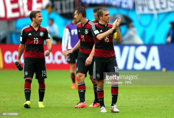 Philipp Lahm Miroslav Klose and Mario Goetze of Germany celebrate the 10 win after the 2014 FIFA World Cup Brazil Group G match between USA and...
