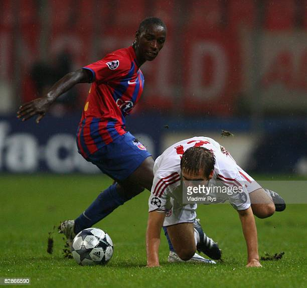 Philipp Lahm of Bayern and Antonio Semedo of Steaua battle for the ball during the UEFA Champions League Group F match between FC Steaua Bucuresti...