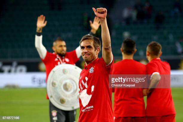 Philipp Lahm of Bayern celebrates after winning the German Championship after winning 60 the Bundesliga match between VfL Wolfsburg and Bayern...