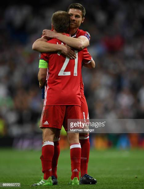 Philipp Lahm of Bayern Muenchen and Xabi Alonso of Bayern Muenchen embrace after the UEFA Champions League Quarter Final second leg match between...