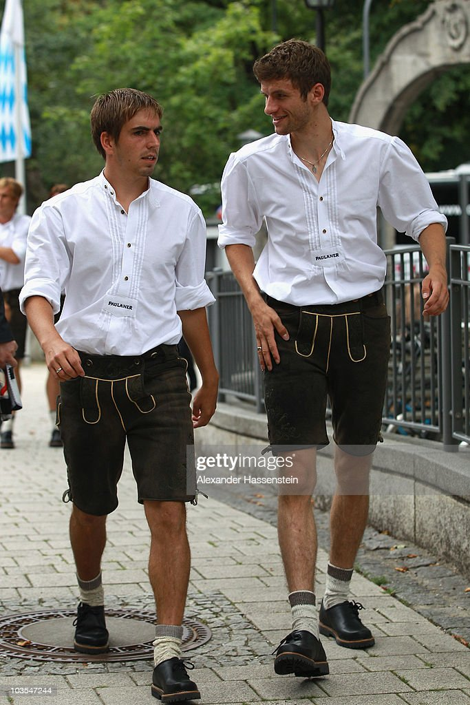 Philipp Lahm (L) of Bayern Muenchen arrives with his team mate Thomas Mueller for the Paulaner photocall at the Nockerberg Biergarden on August 23, 2010 in Munich, Germany.