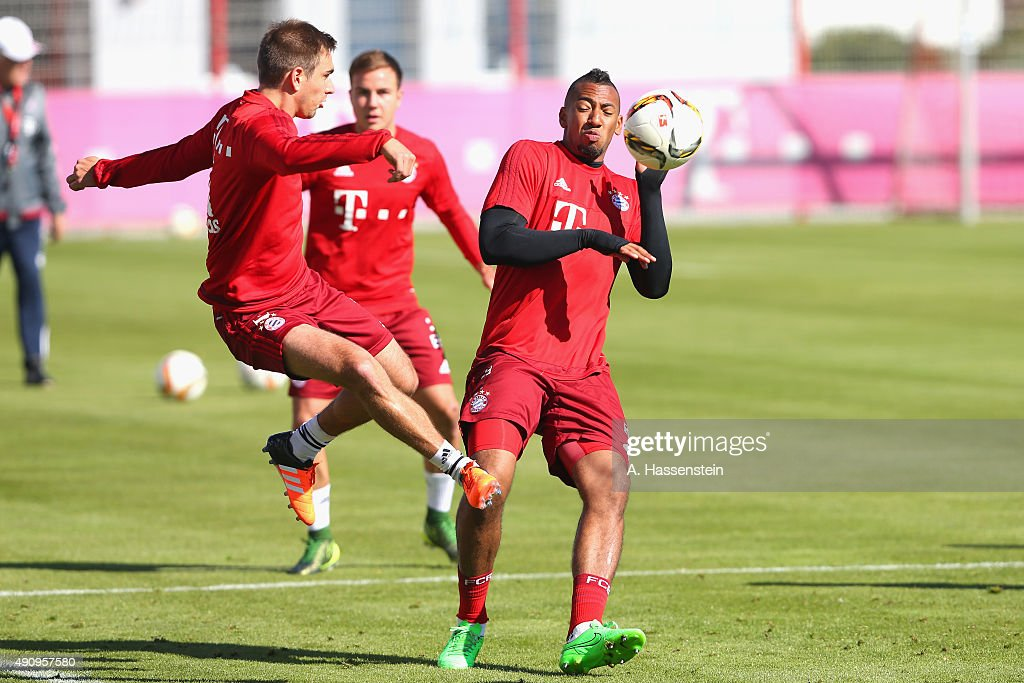 Philipp Lahm (L) of Bayern Muenchen battles for the ball with his team mate Jerome Boateng during a training session at Bayern Muenchen's trainings ground Saebener Strasse on October 2, 2015 in Munich, Germany.