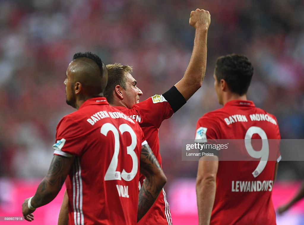 Philipp Lahm (C) of Bayern Muenchen celebrates his team's fourth goal during the Bundesliga match between Bayern Muenchen and Werder Bremen at Allianz Arena on August 26, 2016 in Munich, Germany.