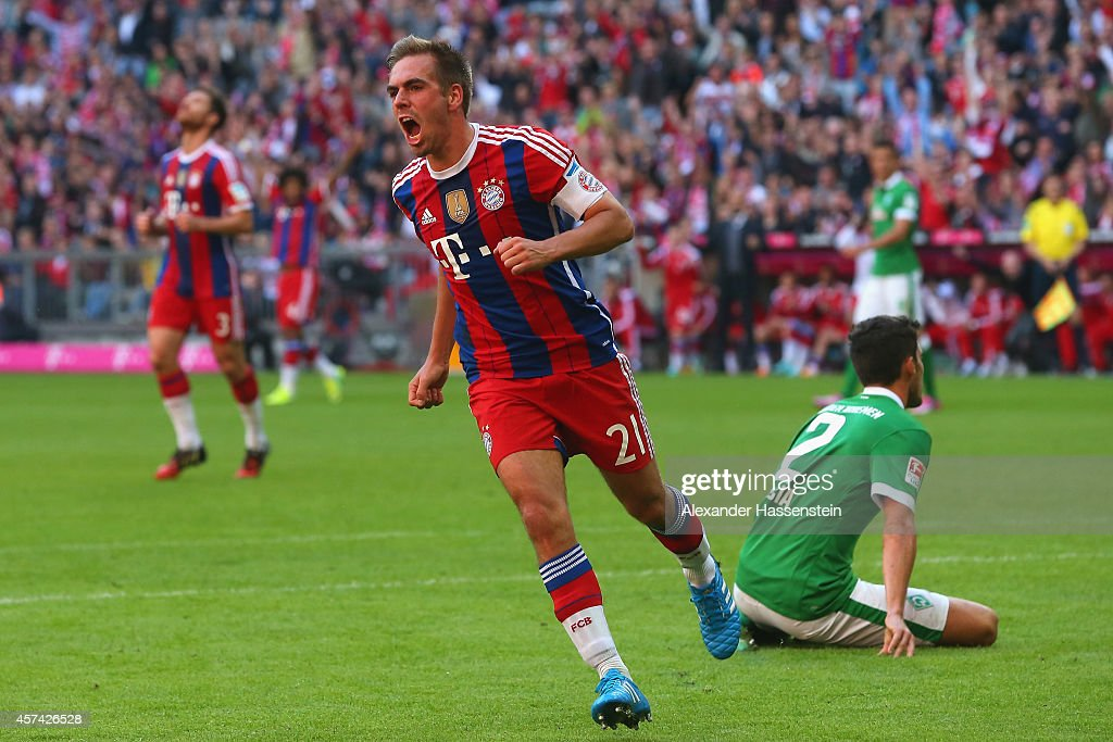Philipp Lahm of Bayern Muenchen celebrates scoring the opening goal during the Bundesliga match between FC Bayern Muenchen and SV Werder Bremen at Allianz Arena on October 18, 2014 in Munich, Germany.