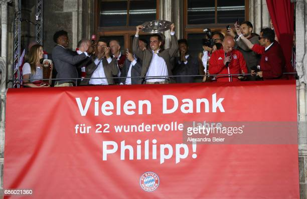 Philipp Lahm of Bayern Muenchen celebrates winning the 67th German Championship title on the town hall balcony at Marienplatz on May 20 2017 in...