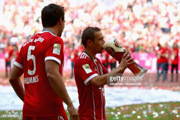 Philipp Lahm of Bayern Muenchen drinks beer following the Bundesliga match between Bayern Muenchen and SC Freiburg at Allianz Arena on May 20 2017 in...