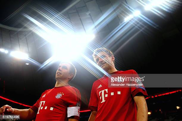 Philipp Lahm of Bayern Muenchen enters the field with his team mate Thomas Mueller for the UEFA Champions League quarter final first leg match...