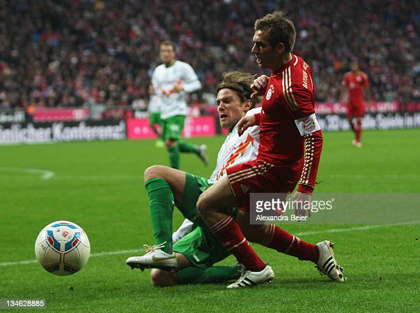 Philipp Lahm of Bayern Muenchen fights for the ball with Clemens Fritz of Werder Bremen during the Bundesliga match between FC Bayern Muenchen and SV...