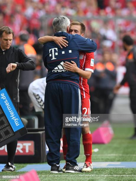 Philipp Lahm of Bayern Muenchen hugs Carlo Ancelotti Manager of Bayern Muenchen following the Bundesliga match between Bayern Muenchen and SC...