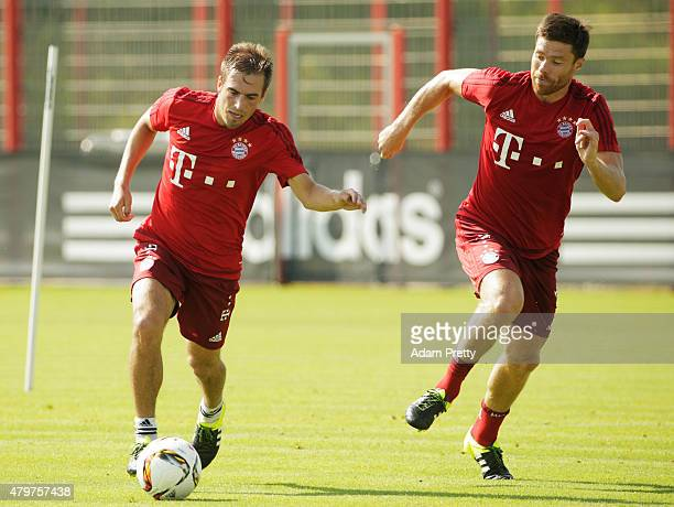 Philipp Lahm of Bayern Muenchen is challenged by Xabi Alonso during the FC Bayern Muenchen Training Session at the Bayern Munich training grounds on...