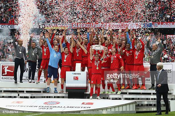 Philipp Lahm of Bayern Muenchen lifts the Bundesliga trophy to celebrate winning the German Championship after the Bundesliga match FC Bayern...