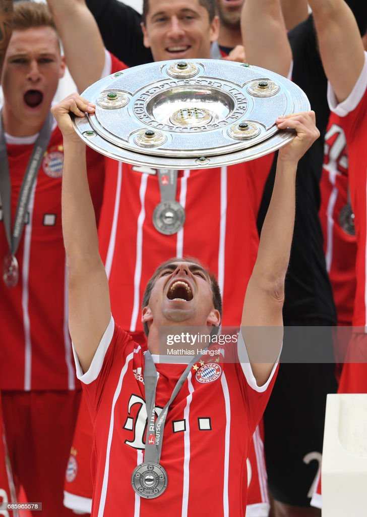 Philipp Lahm of Bayern Muenchen lifts the Championship trophy in celebration of the 67th German Championship title following the Bundesliga match between Bayern Muenchen and SC Freiburg at Allianz Arena on May 20, 2017 in Munich, Germany.