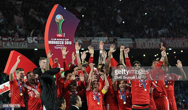 Philipp Lahm of Bayern Muenchen lifts the trophy following the FIFA Club World Cup Final match between Bayern Muenchen and Raja Casablanca at...