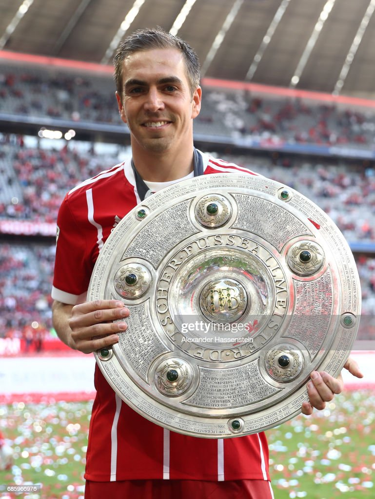 Philipp Lahm of Bayern Muenchen poses with the Championship trophy in celebration of the 67th German Championship title following the Bundesliga match between Bayern Muenchen and SC Freiburg at Allianz Arena on May 20, 2017 in Munich, Germany.