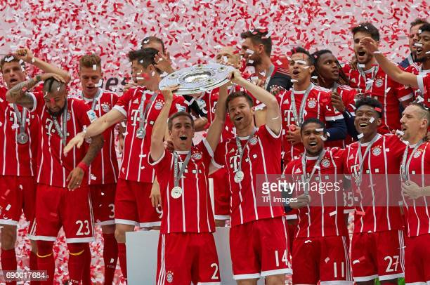 Philipp Lahm of Bayern Muenchen and Xabi Alonso of Bayern Muenchen ERMANY MAY 20 Philipp Lahm of Bayern Muenchen poses with the Championship trophy...