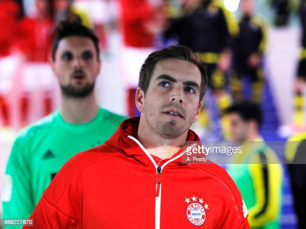 Philipp Lahm of Bayern Muenchen prepares himself before the Bundesliga match between Bayern Muenchen and Borussia Dortmund at Allianz Arena on April...
