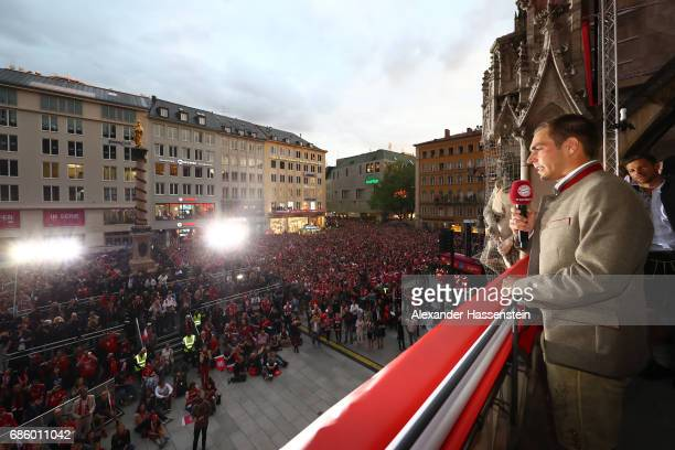 Philipp Lahm of Bayern Muenchen speaks to the fans as they celebrate winning the 67th German Championship title on the town hall balcony at...