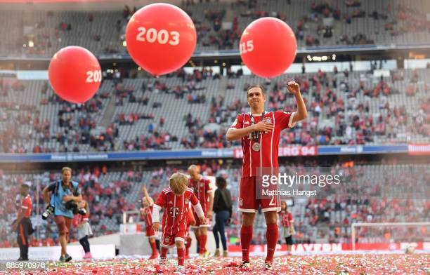 Philipp Lahm of Bayern Muenchen waves to the fans after the presentation of the 67th German Championship title following the Bundesliga match between...
