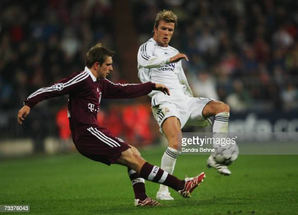 Philipp Lahm of Bayern Munich challenges David Beckham of Real Madrid during the UEFA Champions League Round of 16 first leg match between Real...