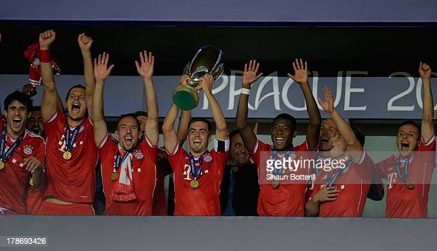Philipp Lahm of Bayern Munich lifts the trophy as he celebrates with his team mates during the UEFA Super Cup between Bayern Muenchen and Chelsea at...