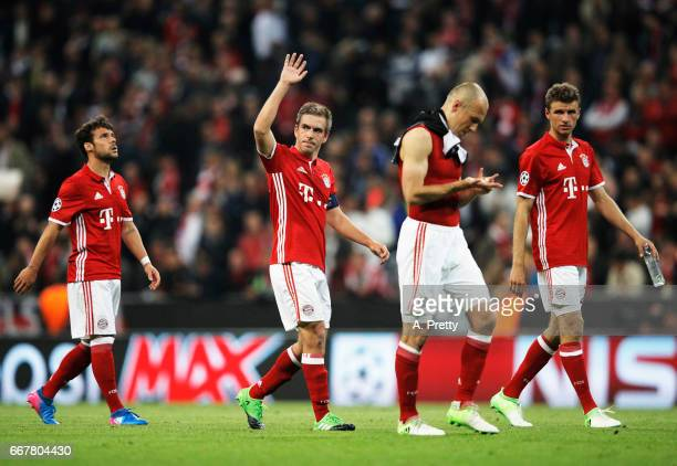 Philipp Lahm of Bayern Munich thanks the fans after the UEFA Champions League Quarter Final first leg match between FC Bayern Muenchen and Real...