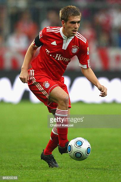 Philipp Lahm of Bayern runs with the ball during the Bundesliga match between Bayern Muenchen and Bayer Leverkusen at the Allianz Arena on November...