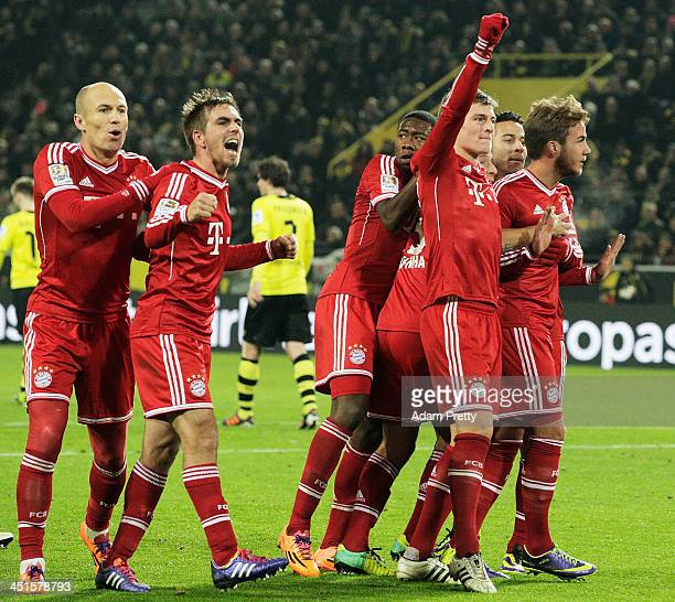 Philipp Lahm of FC Bayern celebrates with teamates after Mario Gotze of FCBayern scores a goal during the Bundesliga match between FC Bayern and Bor...