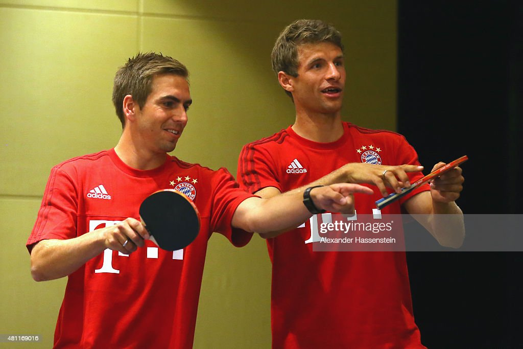 Philipp Lahm (L) of FC Bayern Muenchen and his team mate Thomas Mueller plays a table tennis match broadcasted live on TV at Inter Continental Beijing Beichen Hotel during day 2 of the FC Bayern Audi China Summer Pre-Season Tour on July 18, 2015 in Beijing, China.