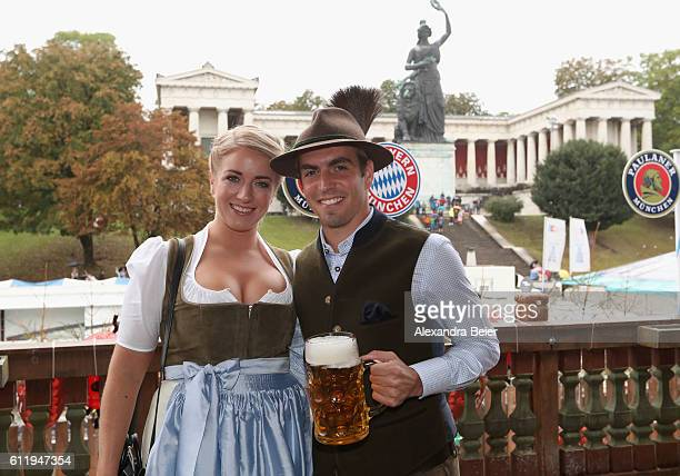 Philipp Lahm of FC Bayern Muenchen and his wife Claudia attend the Oktoberfest beer festival at Kaefer Wiesenschaenke tent at Theresienwiese on...