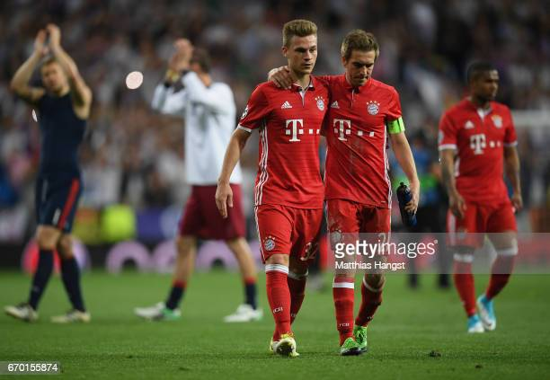 Philipp Lahm of FC Bayern Muenchen and Joshua Kimmich of FC Bayern Muenchen seen after the UEFA Champions League Quarter Final second leg match...