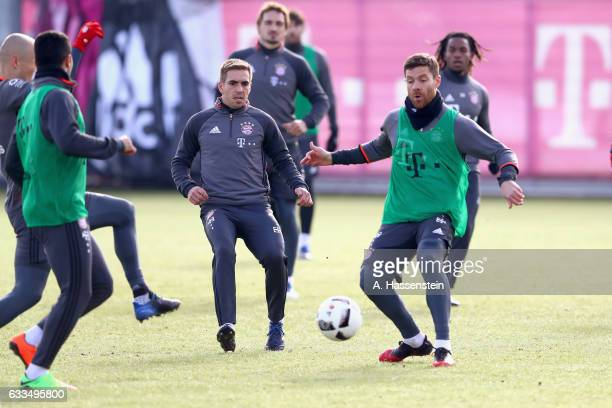 Philipp Lahm of FC Bayern Muenchen battles for the ball with his team mate Xabi Alonso during a training session at Saebener Strasse training ground...