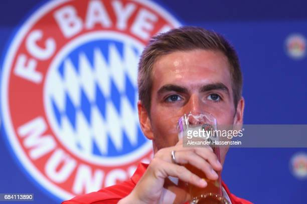 Philipp Lahm of FC Bayern Muenchen enjoys a beer after a fun table top football match at Paulaner headquarter Munich on May 17 2017 in Munich Germany