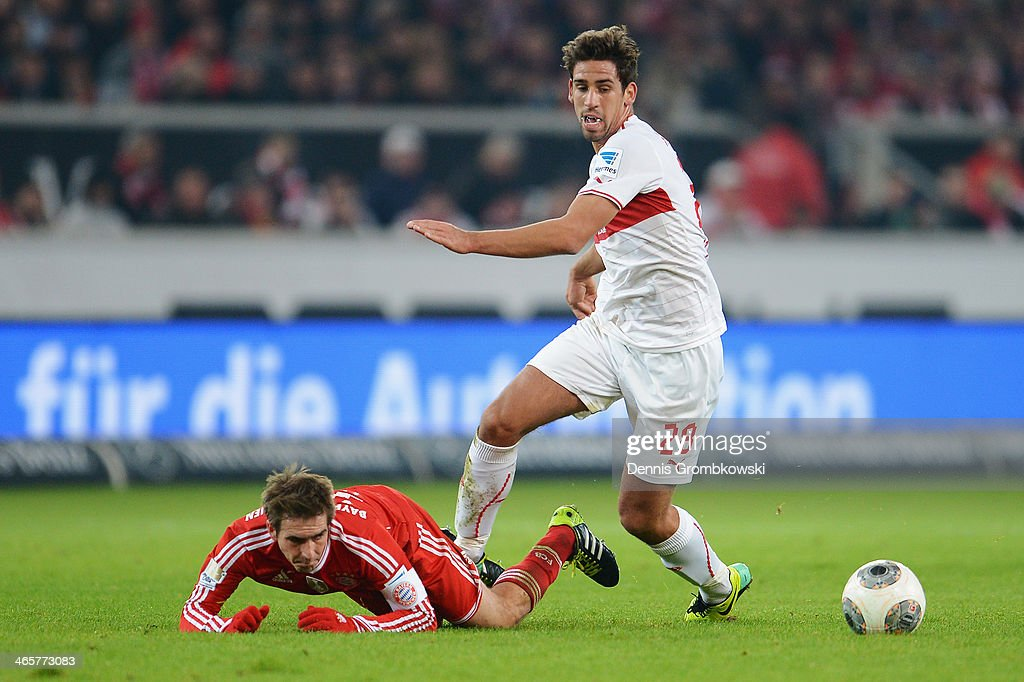 Philipp Lahm of FC Bayern Muenchen is challenged by Rani Khedira of VfB Stuttgart during the Bundesliga match between VfB Stuttgart and FC Bayern Muenchen at Mercedes-Benz Arena on January 29, 2014 in Stuttgart, Germany.