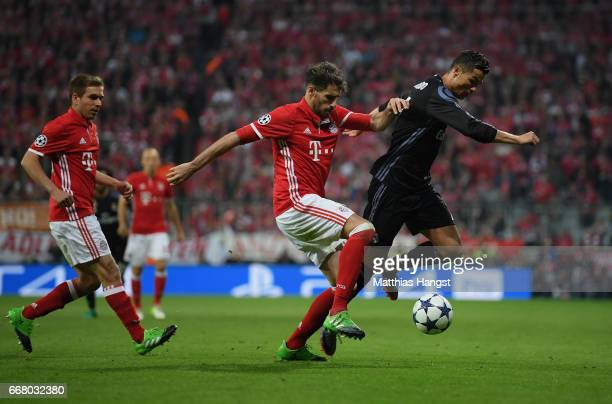 Philipp Lahm of FC Bayern Muenchen , Javi Martinez of FC Bayern Muenchen and Cristiano Ronaldo of Real Madrid compete for the ball during the UEFA...
