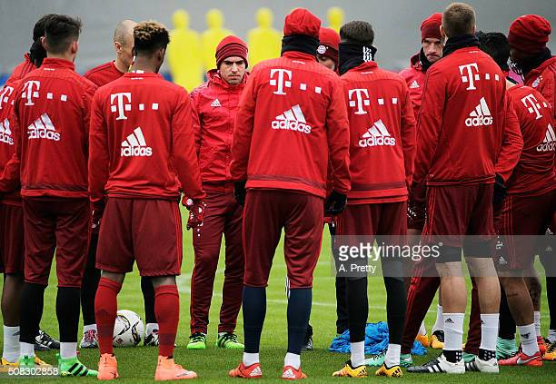Philipp Lahm of FC Bayern Muenchen listens to the team talk during training at the FC Bayern Muenchen training grounds on February 4 2016 in Munich...