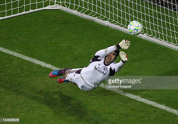 Philipp Lahm of FC Bayern Muenchen scores a penalty in the shoot out past Petr Cech of Chelsea during UEFA Champions League Final between FC Bayern...