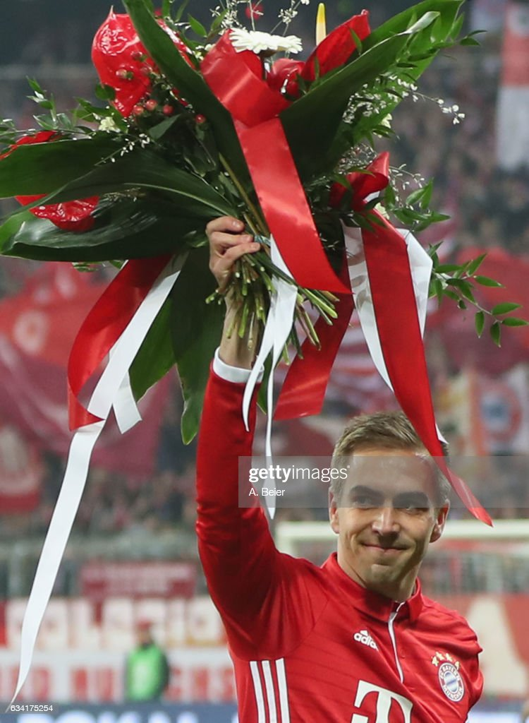 Philipp Lahm of FC Bayern Muenchen smiles as he is honoured by the club for having played his 500th soccer match for FC Bayern Muenchen before the DFB Cup Round Of 16 match between Bayern Muenchen and VfL Wolfsburg at Allianz Arena on February 7, 2017 in Munich, Germany. Philipp Lahm told the media on Tuesday that he will retire at the end of the season.